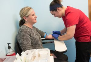 Clinical research coordinators are trained to take blood samples from clients.