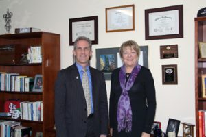 NECC President Lane Glenn congratulates Kathy Ronaldson, assistant director of NECC's Center for Corporate and Community Education.
