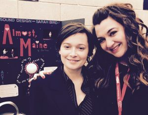NECC theater major Sarah Bird and adjunct theater professor Brianne Beatrice stand in front of Bird's presentation for the Kennedy Center American College Theater Festival sound design exhibition, for which she won the Focal Press/Rafael Jaen Showcase Award for Excellence in Sound Design.