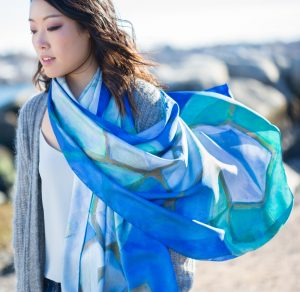 """The scarf at the center of """"The Scarf Project: Nurturing the Tie Between Art & Healing"""" features a painting by NECC art professor Bonnie Ashmore, whose work explores the molecular structure of chemotherapeutic agents found in nature."""