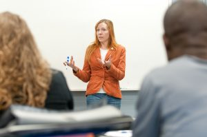 """Professor Kristi Arford leads a class for current and prospective NECC students at the school's """"College for a Day"""" event."""