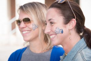 Staff members sport NECC temporary face tattoos