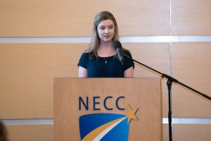 """Whittier Vo-Tech senior Allasandra """"Ally"""" Thompson of Haverhillat podium during Early College Recognition Ceremony."""