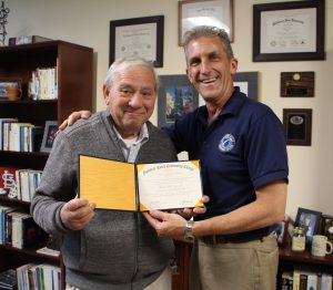 Ted Gaiero receives his degree from NECC President Lane Glenn.