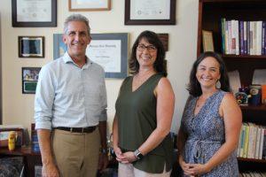 NECC President Lane Glenn congratulates employees Kathleen Bartolini and Janet D'Agata-Lynch on receiving Employee Recognition Award