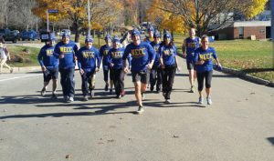 President Lane Glenn with faculty, staff, and students running on the Haverhill campus.