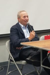 Larry Summers speaking into a microphone.
