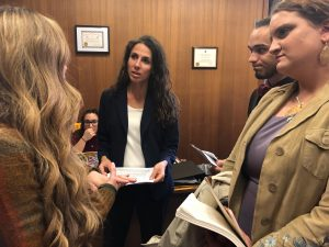 Senator DiZoglio is seen talking with students from NECC