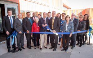 President Lane Glenn and retired president John Dimitry cut the ribbon to the renovated Dimitry building.
