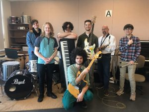 Photo of members of the NECC Jazz ensemble  with instruments