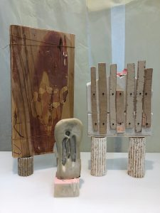 art work made from wood and plaster