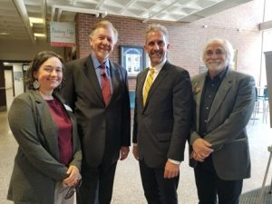 Guest speaker Westy Egmont , Janel D'Agata-Lynch, Presedient Lane Glenn, and Paul Saint-Amand stand in the Spurk foyer. ,