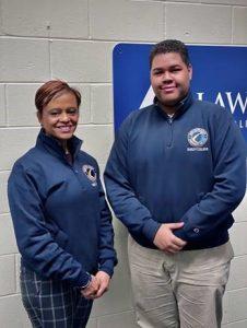 VP Noemi Custodia Lora and Joeph Trinidad both wearing Lawrence Alliance in Education sweaters.