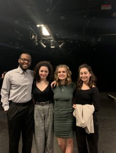 theater students standing on a stage
