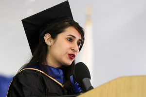 Yexis Hechavarria in cap and gown delivering the 2019 student commencement speech.