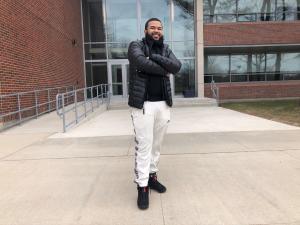 Jeurys standing in front of brick NECC building