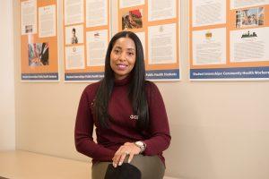 Portrait of Roseanna Lara sitting in an NECC hallway.