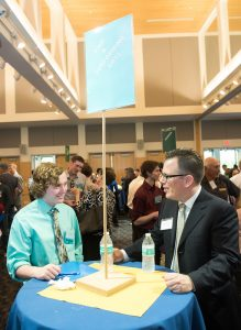 Student and employer speak during 2017 networking night