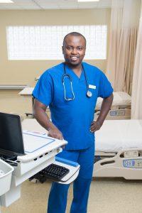 Male nursing student poses in NECC's Nursing Lab.