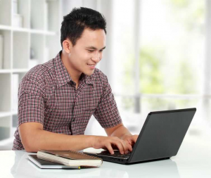 graphic of prospective student in front of a laptop