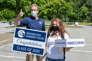 President Lane Glenn gives the thumb up with NECC 2020 grad. Both are wearing masks.