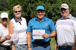 Golf team of four, two women and two men