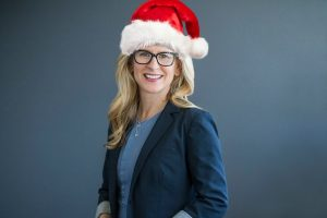 woman with blonde hair wearing a Santa hat