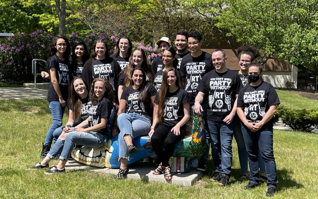 Group of 16 Rad tech graduates pose in matching t-shirts on the haverhill campus