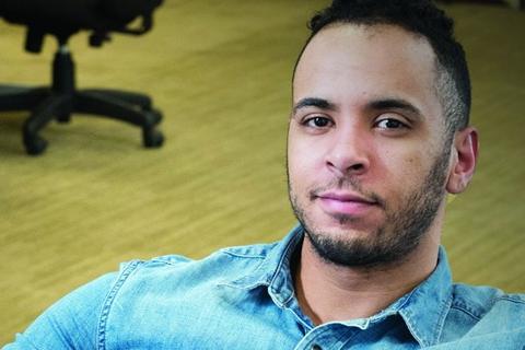 Carlos Rivera smiling at the camera