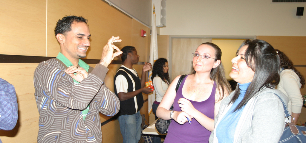 Members of the ASL chatting with students
