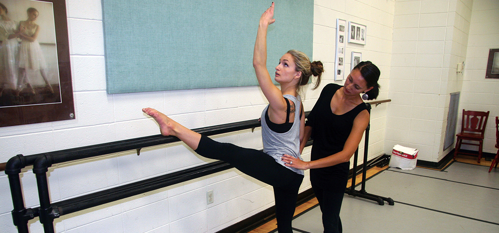 Instructor teaching dance to a student