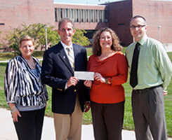 President Lane accepts a donation to the NECC Fund