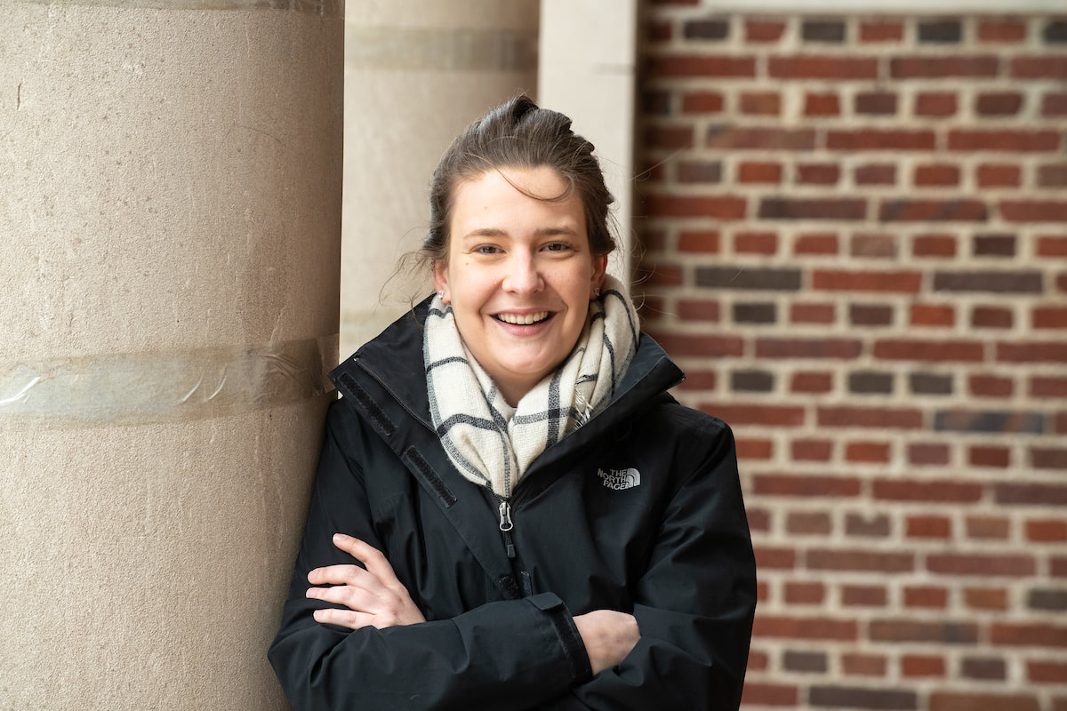 A portrait of NECC student Reanne Malesky against a brick wall