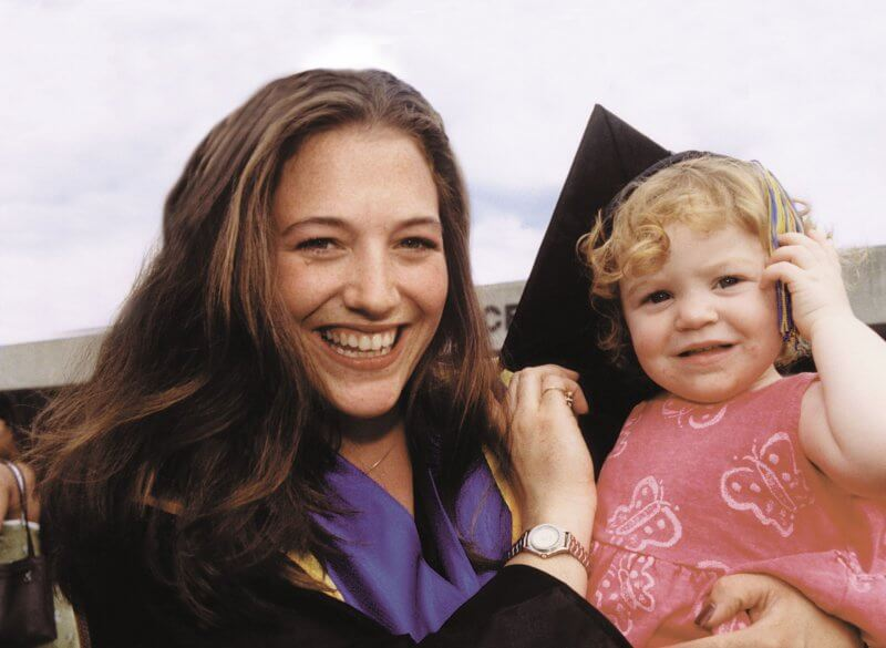 Graduate with child.