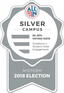 "Award ribbon that says: ""All In"" Silver Campus 30 to 39 percent voting rate. Excellence in Student voter engagenment, midterm 2018 election."