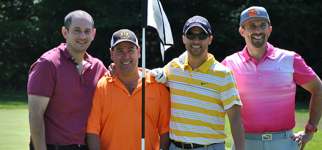 Four alumni on the golf field