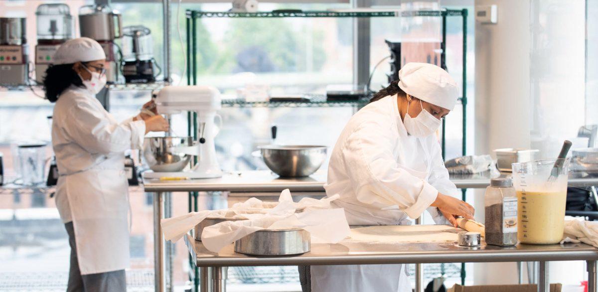 Students of Culinary Arts preparing a dish