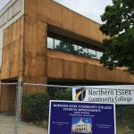 Dimitry Construction 07-02-18 Outside -Siding removed 3, NECC and NECC construction sign on fence