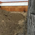 Dimitry Renovations: A hill of dirt in front of the building-09-10-18