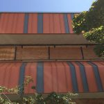 Dimitry Renovations: Close-up of completed siding on top and bottom,with vertical colors of dark orange and grey (mostly orange) 08-27-2018
