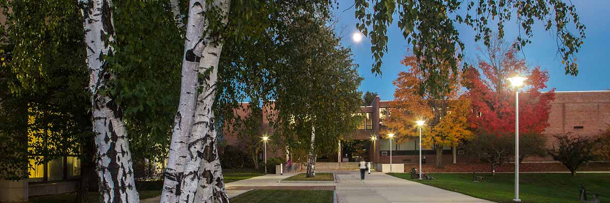 The haverhill campus in the fall with several buildings, colorful trees, and well lit wide walkways -At the NECC information session online you can learn more about this campus and our Lawrence campus as well.