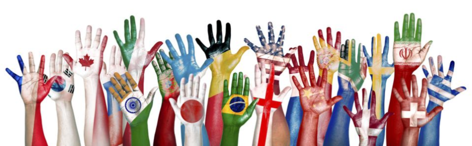 Raised hands, painted with flag colors and designs.