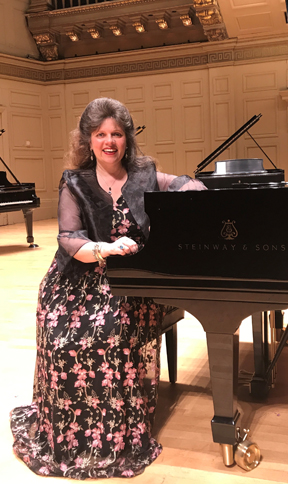 Christina Dietrich, seated at a grand piano in the music room.