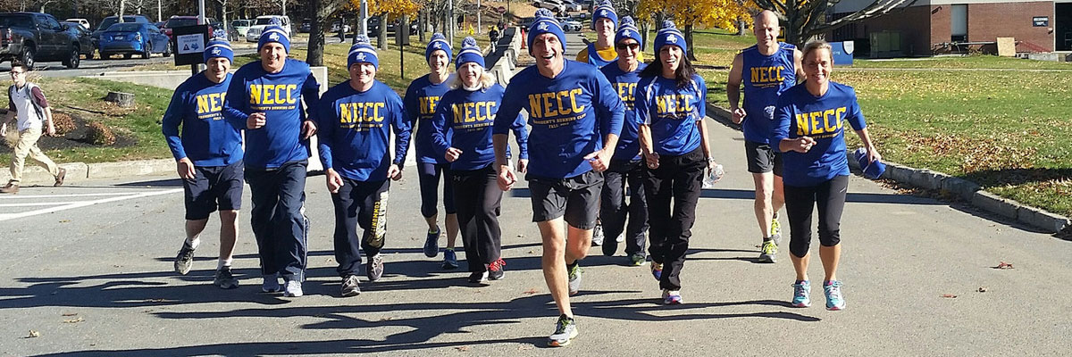 President Glenn running with 10 members of the president's running club.