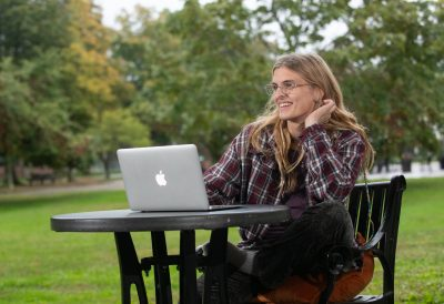 Gwynethe Glickman stars as Sugar in NECC's production of Tiny Beautiful Things outside on the Haverhill campus