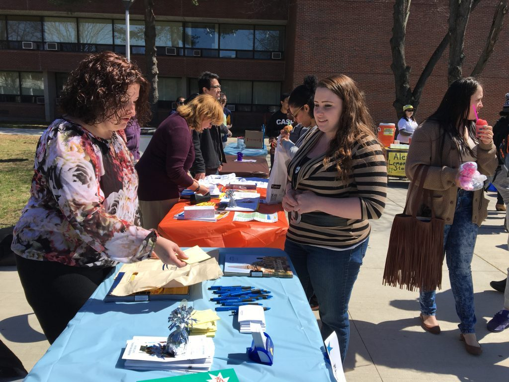 A student visits the GURC resource table at Spring Jam