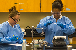 two students work in a lab