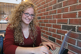 a student works on her laptop in a cafe