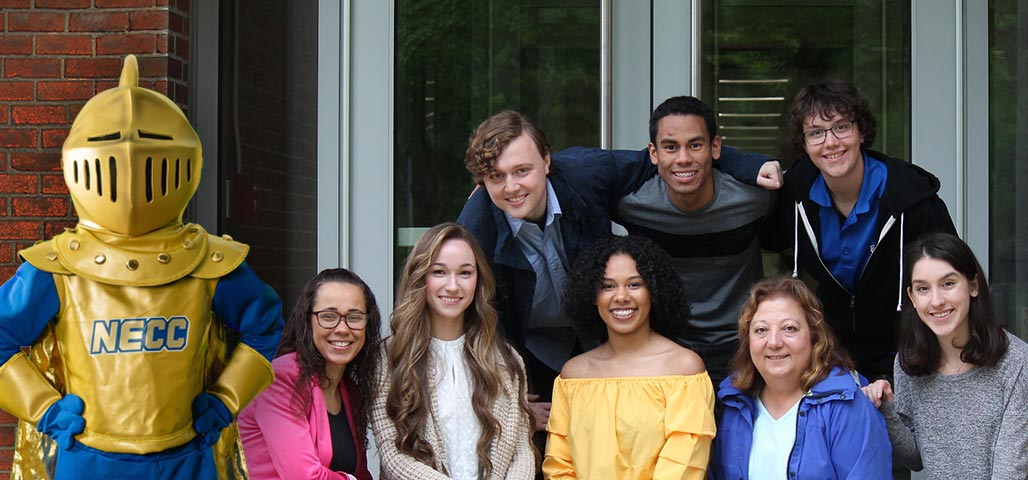 The NECC Knight with 8 NECC students eligible to apply for the Knight's First-Year Scholarship.