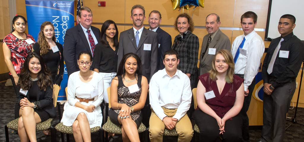 A group of presidential scolarship winners, their guidance counselors and NECC President Lane Glenn